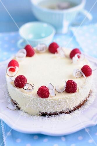 Mango and coconut cake with raspberries