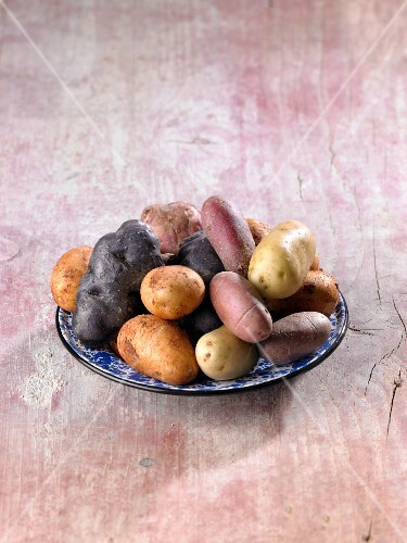 Various different potatoes on a plate
