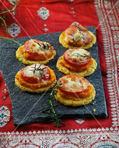 Polenta cakes with pumpkin, tomato and mozzarella (Ayurvedic cuisine)
