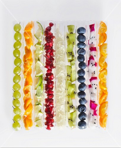 Various types of fruit in test tubes