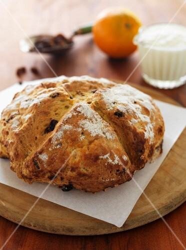 Soda bread with raisins on a wooden board