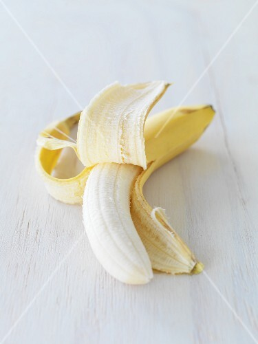A half-peeled banana