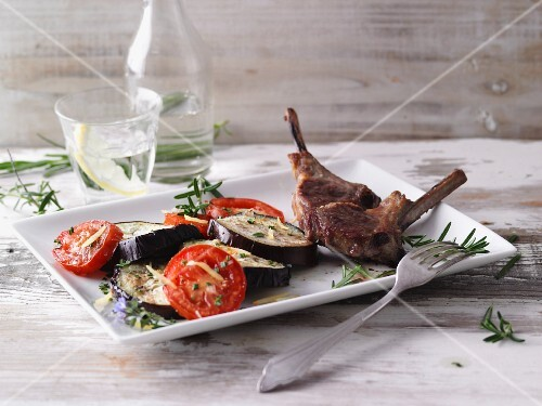 Lamb chops with an aubergine and tomato medley