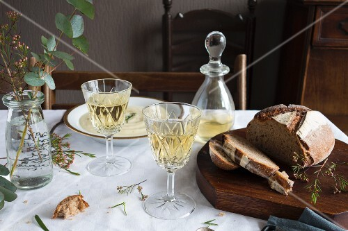 A table laid with bread soup, bread and wine