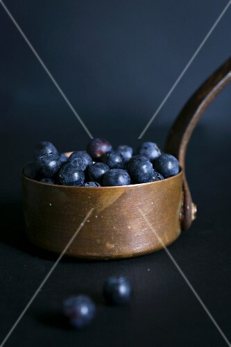 Blueberries in a copper pot