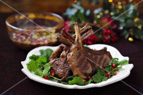 Grilled lamb chops on rocket with pomegranate seeds