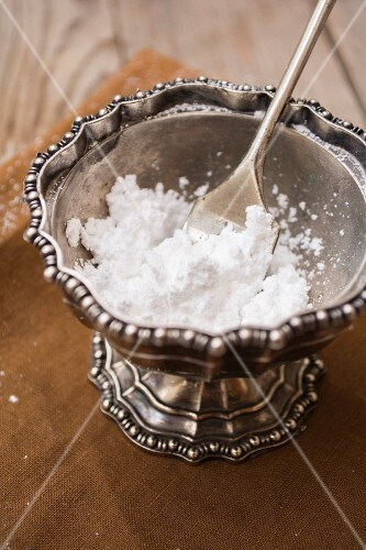 Icing sugar in a old pewter cup