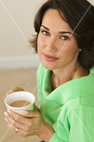 A woman holding a cup of coffee