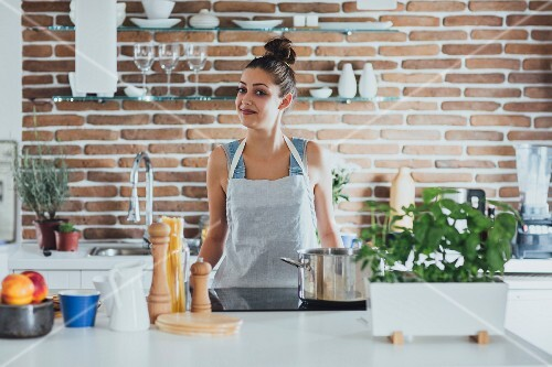 Young woman in apron in a kitchen