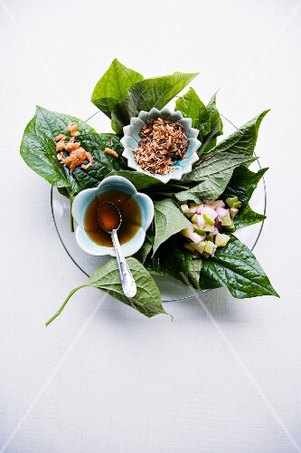 Mieng Kham (an appetiser featuring prawns, coconut, lime and dip served on pepper leaves, Thailand)