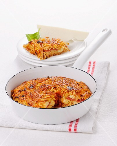 Pasta cake with vermicelli and Provolone in a pan (Italy)