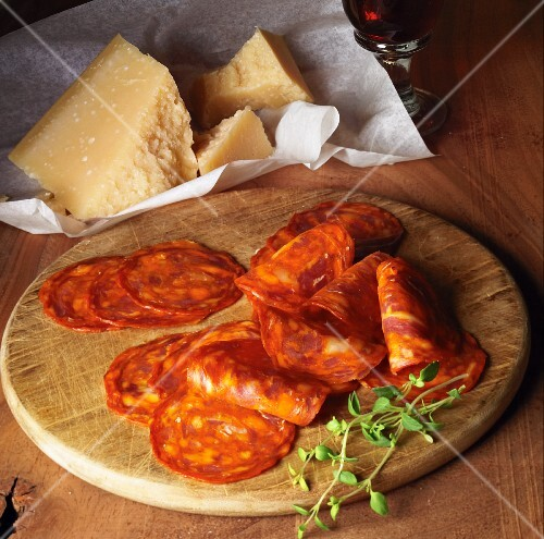 A snack of chorizo and Parmesan cheese