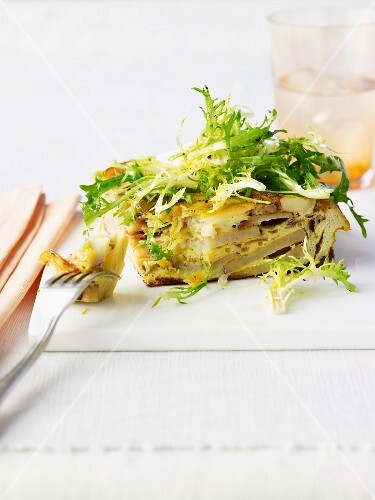 Spanish tortilla with frisee lettuce