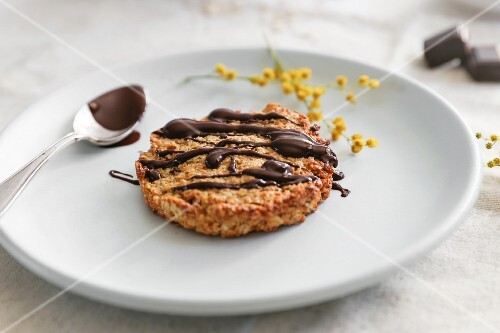 An oat biscuit drizzled with chocolate