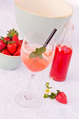 Champagne with ice and rhubarb and strawberry syrup