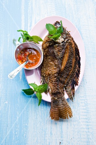 A whole fried fish with chilli sauce, Thailand