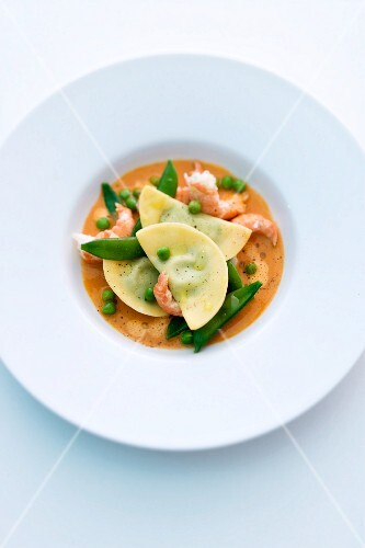 Crayfish with pea ravioli in a butter sauce