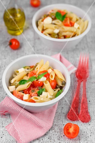 Cold pasta with tomatoes, cheese and basil