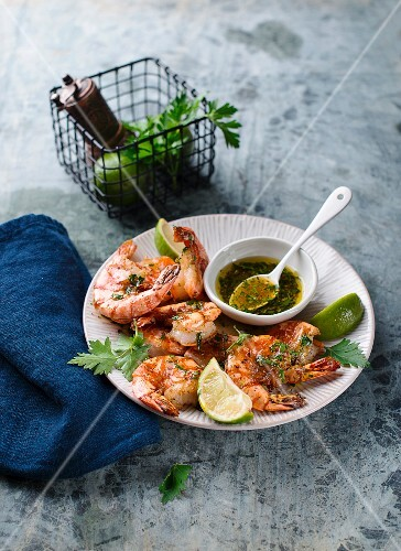 Fried king prawns with herb oil and limes