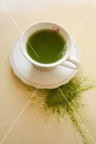 Matcha tea in a cup and as powder