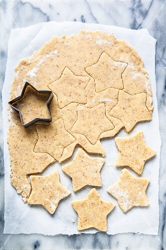 Pistachio star cookies being cut out