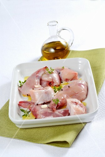 Raw rabbit meat in a marinade