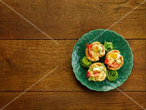 Crispy pastry shells filled with prawns and quail's eggs in saffron sauce