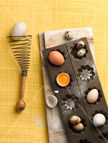 Various eggs in a baking tin