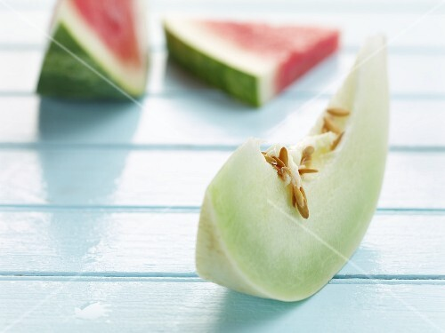 A wedge of honeydew melon and two slices of watermelon