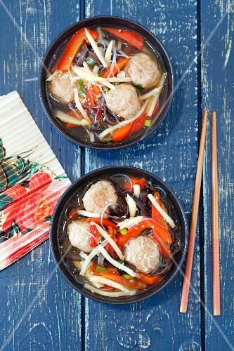 Oriental soup with meatballs, mu-err mushrooms, bamboo shoots, pepper and rice noodles