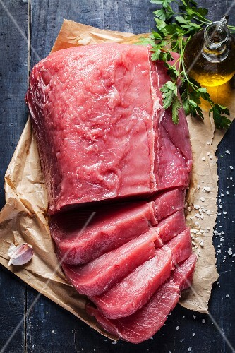 Fresh veal on a piece of paper