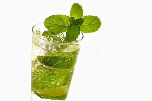 Mojito with lime slices and mint