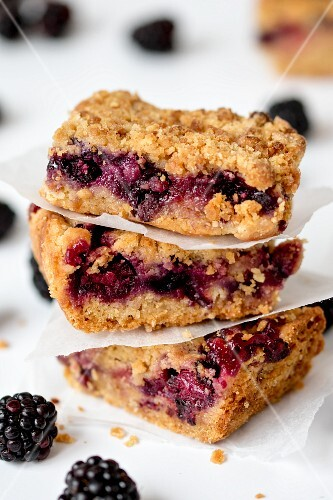 A stack of three slices of blackberry crumble