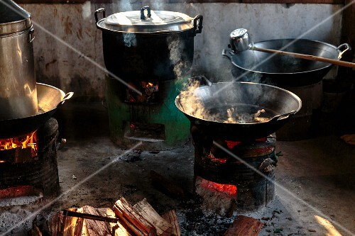 Rice boiling in a wok on a rustic wood-fired stove, Mae Hong Son, Thailand