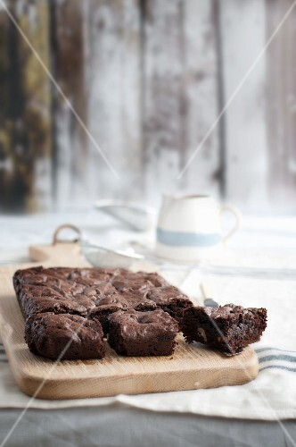 Chocolate brownies on a chopping board