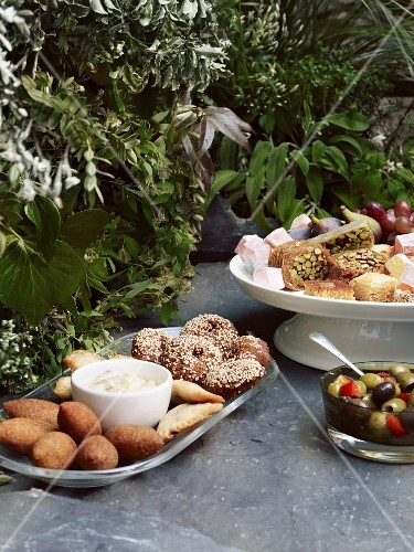A picnic of mezze, olives, baklava and Turkish delight