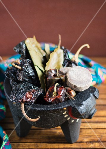 Mexican ingredients in a molcajete (mortar)