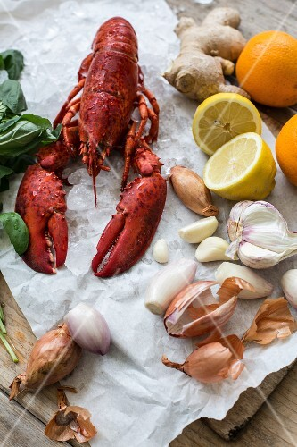 Cooked lobster and various ingredients on a piece of paper