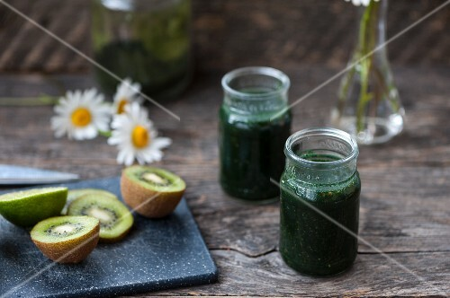 Green smoothies made with chlorella, spirulina, kiwi, limes and parsley