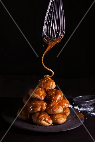 Profiteroles being caramelised