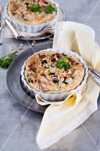 Puff pastry quiche with chard, bacon, goat's cheese and pine nuts