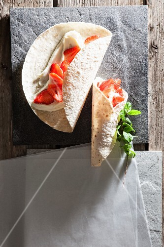 Tortilla wraps with vanilla cream and strawberries