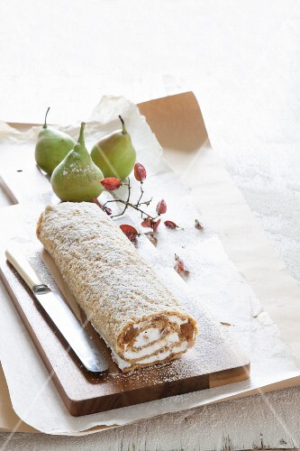 An autumnal Swiss roll with pears and cream