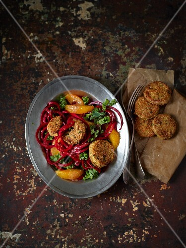 Quinoa balls on a salad of kale, beetroot spirals and oranges