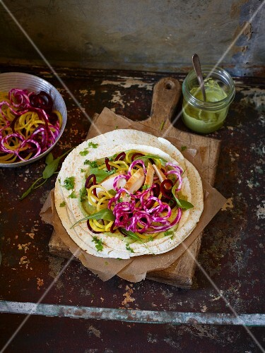 Tortillas with colourful beetroot spirals and chicken breast