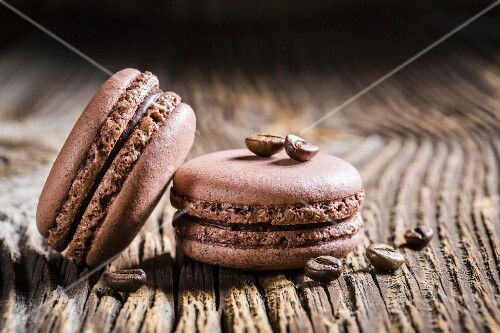 Coffee macaroons on a wooden table