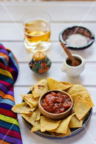 Totopos with a dip (Mexican snack)