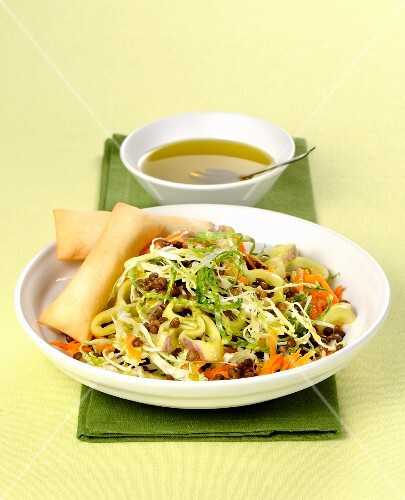 Mixed vegetable salad with lentils and spring rolls