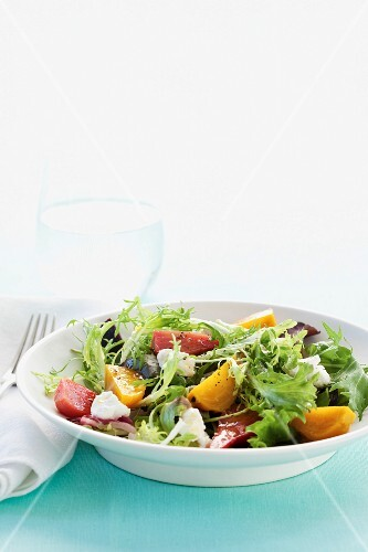 A salad with beetroot, golden beets and feta cheese