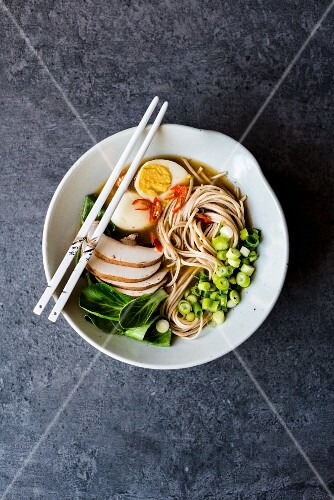 Ramen noodles with vegetables, hard-boiled egg and chilli